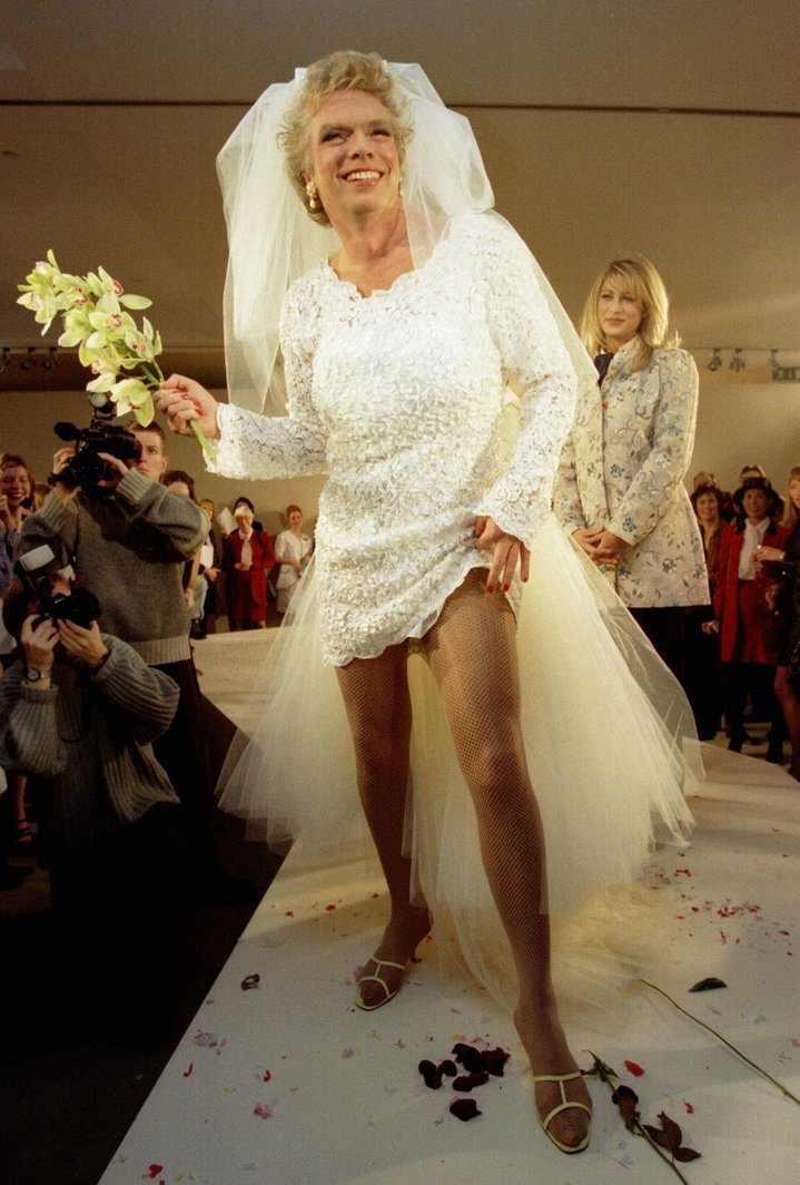 "Entrepreneur Richard Branson shows a bit of leg on the catwalk as he promotes his new business venture ""Virgin Bride"" during its launch December 3. Branson, who shaved his beard for the big event, said his bridal retailing business will revolutionise the wedding industry in the UK.<br />"